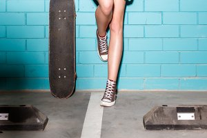 Beautiful girl with skateboard.