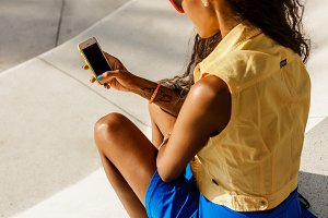 Beautiful black girl with smartphone