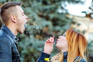 Couple starts soap bubbles