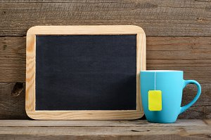 Cup of tea and small blackboard