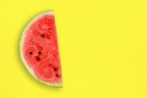 Watermelon slice on yellow table