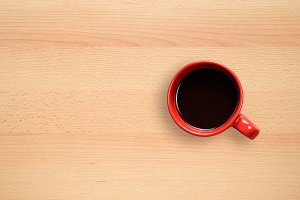 Coffee cup on desktop background