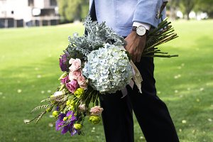 Gentleman with assorted bouquet