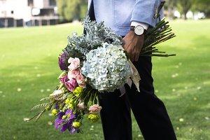Gentleman with assorted bouquet