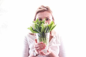 Woman holding Lily of the Valley