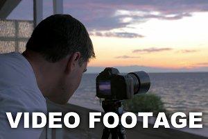 Man shooting timelapse of sunset