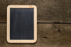 Blackboard on old wood