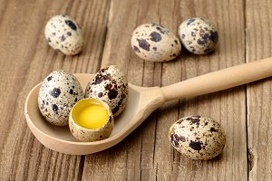 Quail eggs in spoon