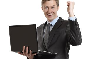 businessman with laptop celebrating winning