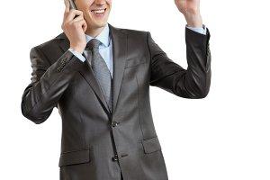 joyful businessman with phone