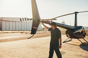 Pilot checking helicopter tail
