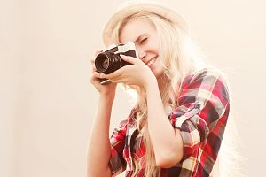 cheerful blonde photographer