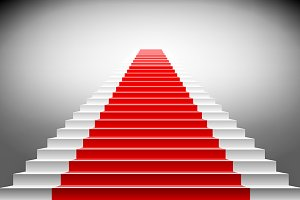 Stairs covered with red carpet.