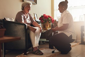 Female nurse visiting senior patient