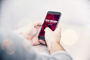 Smartphone in Man's hands PSD Mockup