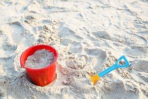 Plastic bucket on beach
