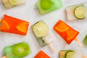 Fruit popsicles on marble