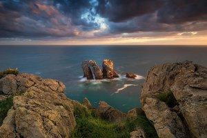 Sunrise over the rocks and sea