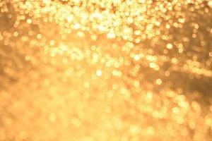 gold blur blinking background