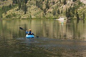 Kayaking on calm lake
