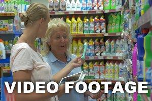 Women choosing household detergents