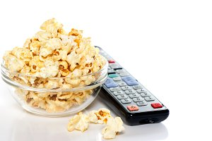 Bowl with popcorn tv remote control