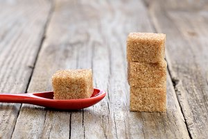 Cane sugar cubes in spoon