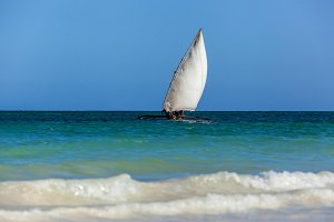 old wooden sailing boat African glides over the waves of the Ind