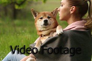 Girl bites ear dog Shiba Inu
