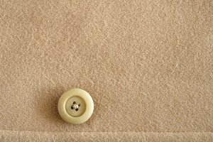 Button on wool fabric