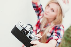 woman photographing herself