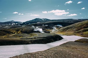 Landscape with moss and snow river in Iceland. Mountain tourism