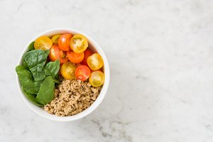 Quinoa with vegetables on marble