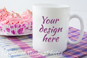 Mug mockup with checkered napkin