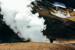 Hiking in Landmannalaugar, mountain landscape with steam in Iceland