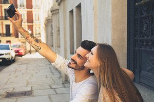 Young couple taking self portrait