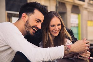 Couple watching iphone and laughing