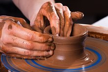 hands making clay pot