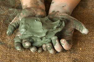 blue clay in hands of child