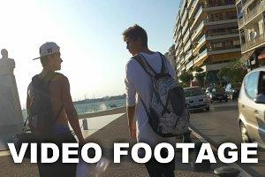 Two guys walking in resort city