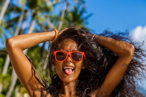 Beautiful black girl in sunglasses.