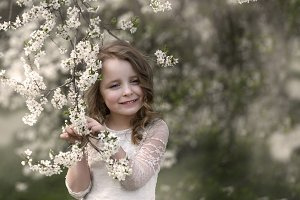 beautiful girl in the spring orchard
