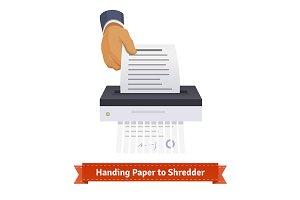 Man handing paper to shredder.