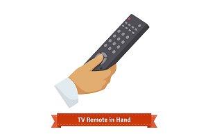 Remote control in hand.