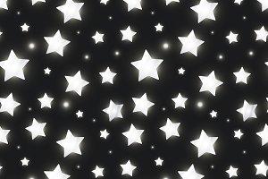 Glossy silver stars in the dark