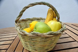 cane basket with fruits