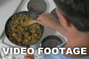 Man cooking stewed vegetables