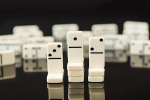 Dominoes illustrating business ideas