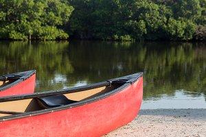 Prow of canoe by lake