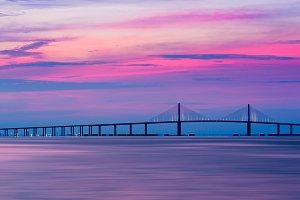 Bridge across ocean at sunrise